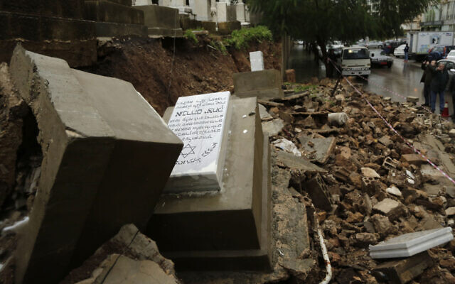 Graves in a Jewish cemetery sit damaged from heavy rains in the Sodeco area of Beirut, Lebanon, Thursday, Dec. 26, 2019.  (AP Photo/Hassan Ammar)