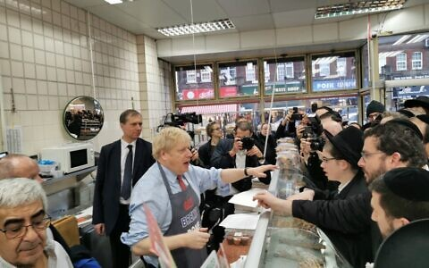Boris Johnson serving doughnuts on the campaign trail at Grodzinski bakery in Golders Green