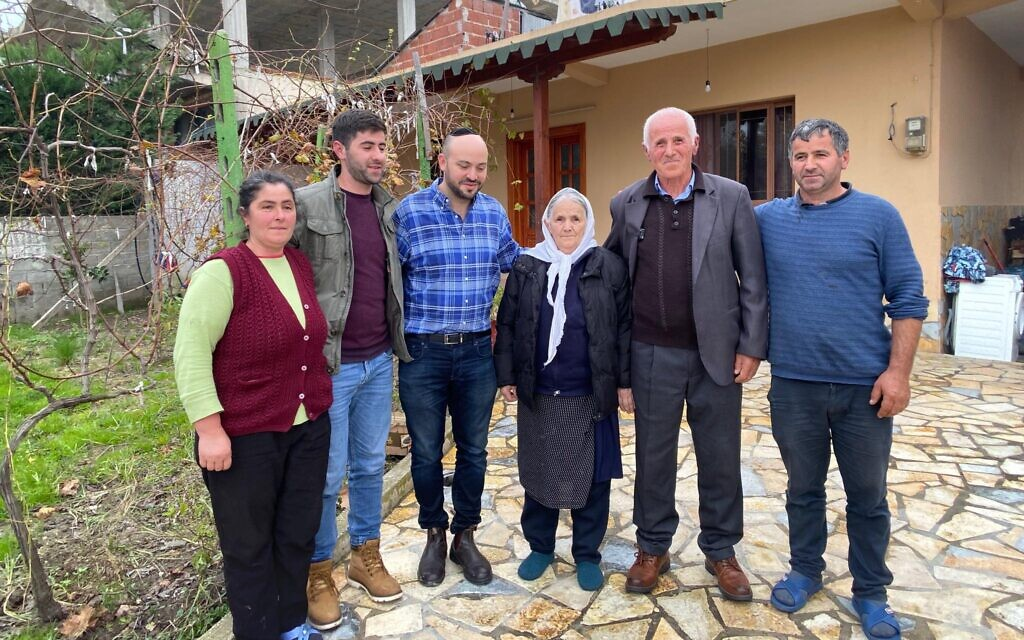 Daniels (third from left) with elderly Albanians affected by the earthquake