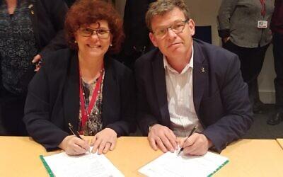 BGU Rector Prof. Chaim Hames (right) and Prof. Dimitra Simeonidou of the University of Bristol sign the MOU on Monday. (Photo Credit: Daphna Frucht/British Embassy Israel)