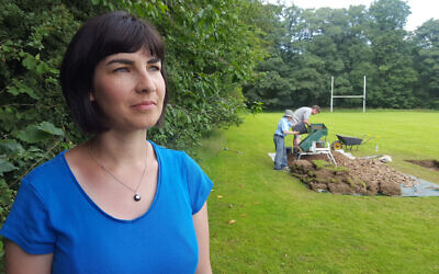 Dr Caroline Sturdy-Colls in front of dig site (Credit:  Rare TV,  Digging for Britain)