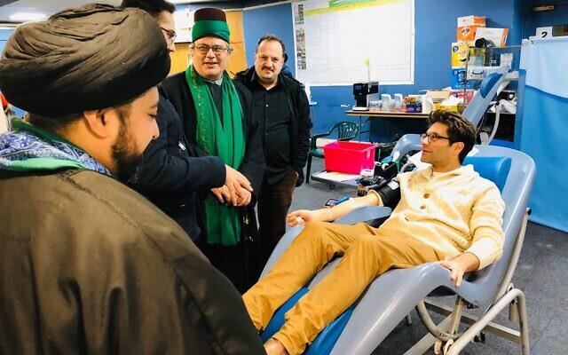 Rabbi Natan Levy gives blood at Golders Green's Islamic centre