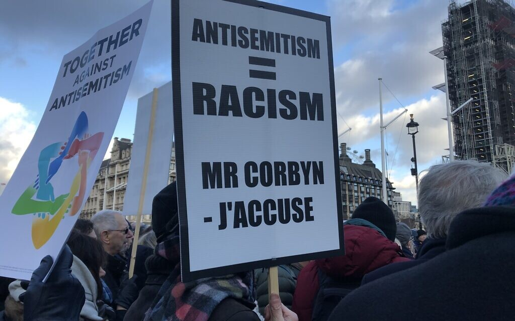 Placard held at Westminster protest against antisemitism