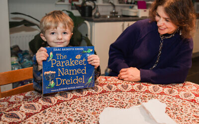 Four-year-old Mischa Sharp received a Chanukah title called The Parakeet Named Dreidel last week, to mark the charity's landmark.