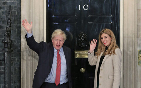 Prime Minister Boris Johnson and his girlfriend Carrie Symonds arrive in Downing Street after the Conservative Party was returned to power in the General Election with an increased majority. PA Photo: Yui Mok/PA Wire