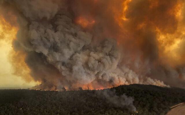 Aerial photo, shows wildfires rage under plumes of smoke in Bairnsdale, Australia.  (Glen Morey via AP)