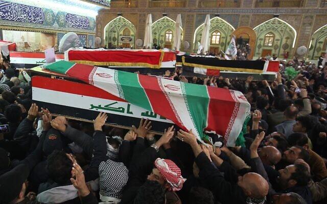 Mourners carry the coffins of Iran's Gen. Qassem Soleimani and Abu Mahdi al-Muhandis, deputy commander of Iran-backed militias at the Imam Ali shrine in Najaf, Iraq, Saturday, Jan. 4,  (AP Photo/Anmar Khalil)