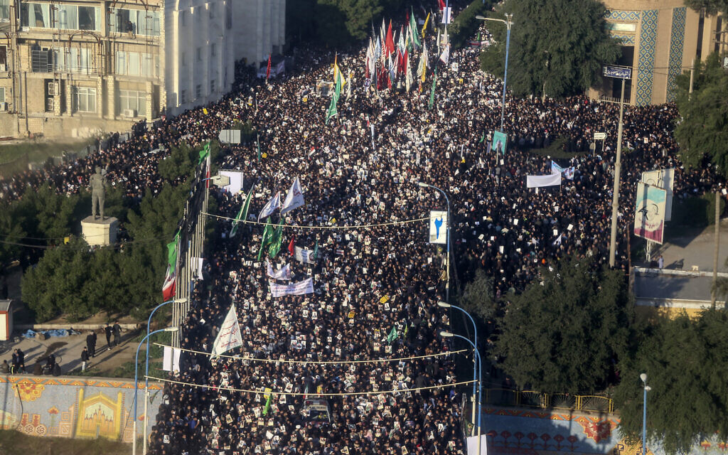 An aerial view shows mourners attending a funeral ceremony for Gen. Qassem Soleimani and his comrades, who were killed in Iraq in a U.S. drone strike, in the southwestern city of Ahvaz, Iran, Sunday, Jan. 5, 2020.  (Morteza Jaberian/Mehr News Agency via AP)