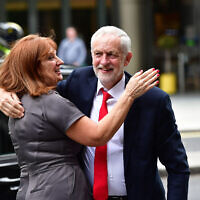 Jeremy Corbyn and Karie Murphy outside the Labour Party HQ in Westminster, London. (Photo credit: Dominic Lipinski/PA Wire)