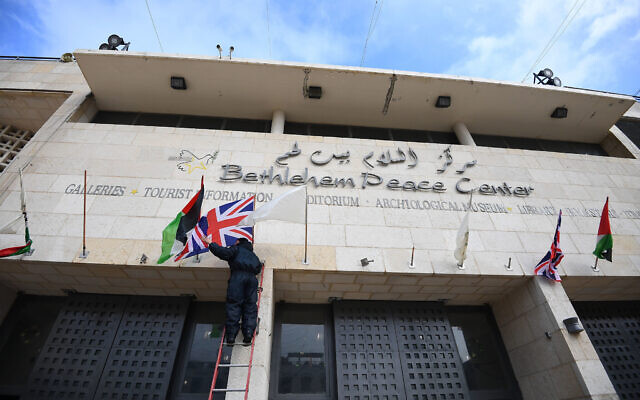 A Union Flag is hung outside the Bethlehem Peace Center in Manger Square, Bethlehem, ahead of the arrival of the Prince of Wales on the second day of his trip to Israel and the occupied Palestinian territories. (Photo credit: Victoria Jones/PA Wire