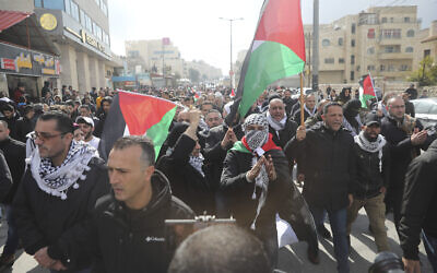 Palestinians protest Middle East peace plan announced Tuesday by US President Donald Trump, which strongly favors Israel, in Bethlehem, West Bank, Wednesday, Jan 29, 2020. (AP Photo/Mahmoud Illean)