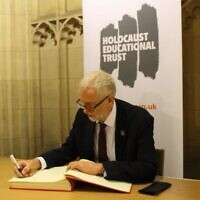Jeremy Corbyn signing the Holocaust Educational Trust's book of commitment last year.
