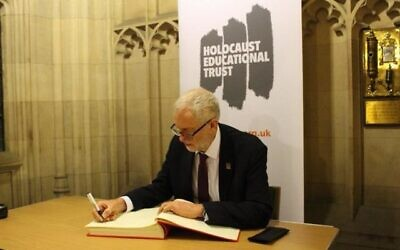 Jeremy Corbyn signing the Holocaust Educational Trust's book of commitment last year. The Labour leader faces calls to distance himself from the Palestine Solidarity Campaign of which he is a patron - after a local branch was accused of promoting Holocaust denial.