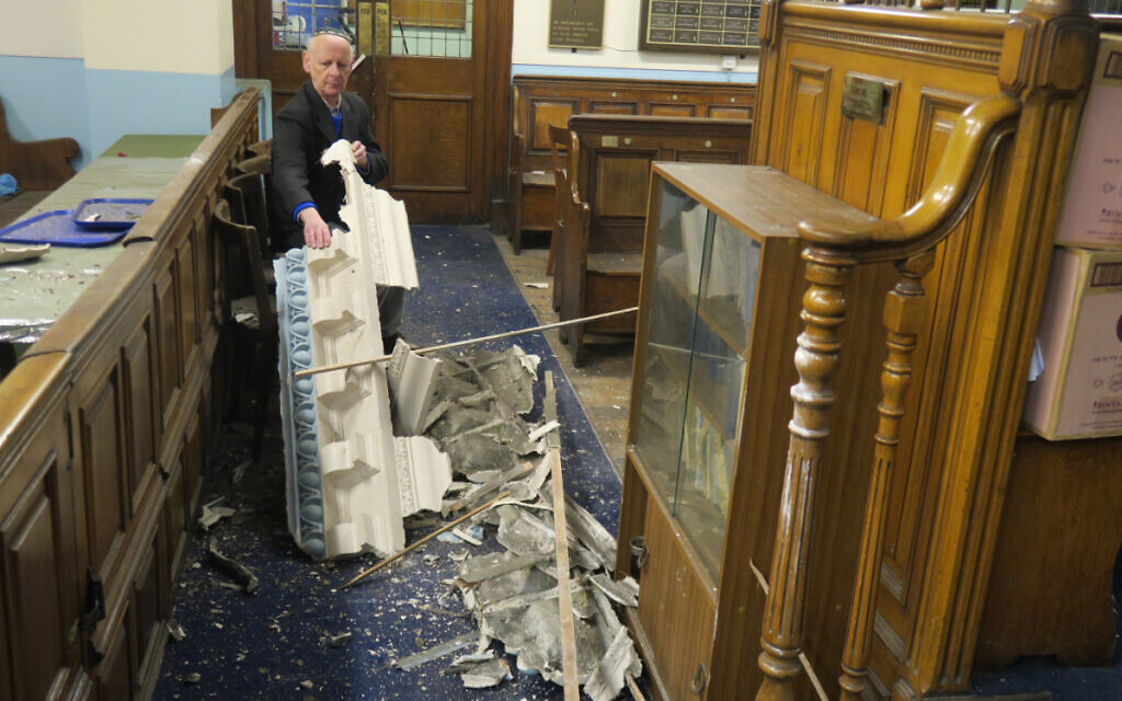 Leon Silver, president of Whitechapel's East London Synagogue, examines the damage to the historic building. (Credit: Mike Brooke/East London Advertiser)