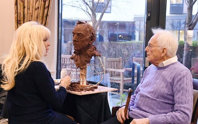 Frances Segelman at Jewish Care's Selig Court sculpting Freddie Knoller (Credit: Sophie Dunne)