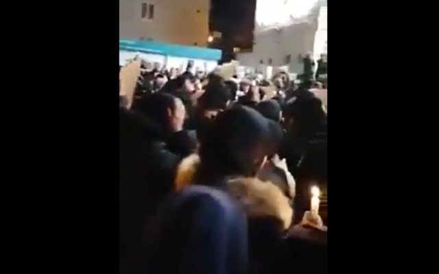 Screenshot from Twitter video showing a vigil outside the Islamic centre