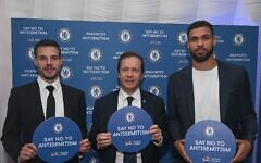 Isaac alongside Chelsea captain César Azpilicueta and the midfielder Ruben Loftus-Cheek  (Photo credit :  Shahar Azran)