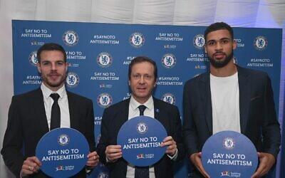 Isaac alongside Chelsea captain César Azpilicueta and the midfielder Ruben Loftus-Cheek  (Photo credit :  Shahar Azran)