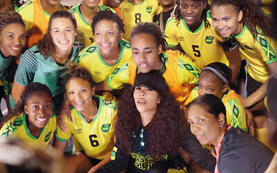 Cedella with the Jamaica girls soccer team