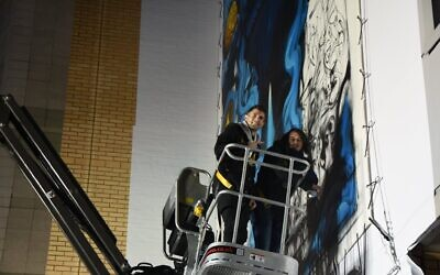 Chelsea star Christian Pulisic with artist Solomon Souza, putting the final touches to the mural