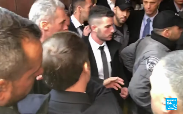 Macron rebuking Israeli security as he tries to enter the Church of St Anne