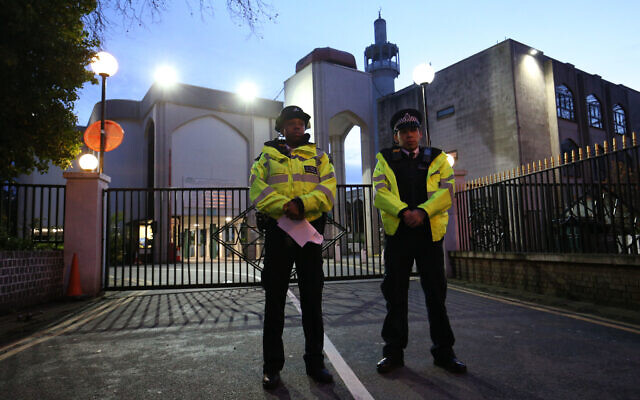Police officers outside the main entrance to the London Central Mosque near Regent's Park, North London, after morning prayers. (Photo credit: Jonathan Brady/PA Wire)