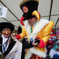 Aalst mayor Christoph D'Haese (R) and a Jewish caricature pictured during the yearly carnival parade in the streets of Aalst, Sunday 23 February 2020, starting on Sunday with the so-called Zondagsstoet. BELGA PHOTO NICOLAS MAETERLINCK