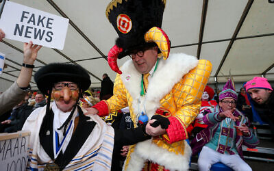 Aalst mayor Christoph D'Haese (R) and a Jewish caricature pictured during the yearly carnival parade in the streets of Aalst, Sunday 23 February 2020, starting on Sunday with the so-called Zondagsstoet.