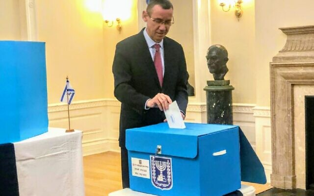 Mark Regev casting his vote