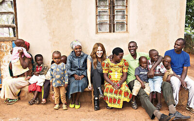 Caroline with Emmanuel and his family.