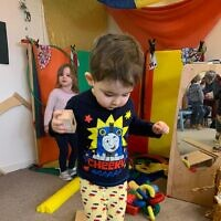 Coby Gold practising circus skills in the nursery's Purim event