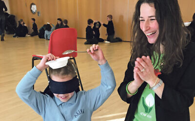 British Friends of Aleh director Liron Rosiner Reshef oversees the cotton wool ball challenge