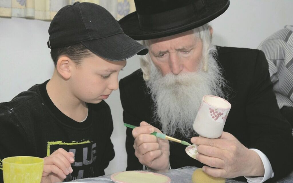 Rabbi Yitzchak Grossman, founder of Migdal Ohr, with a youngster helped by the charity Credit: Geoffrey Alan Photography