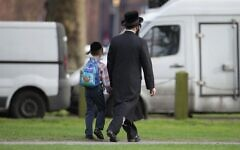 A general view of a Jewish man and a child in Stamford Hill. This image is not related to the article it illustrates.