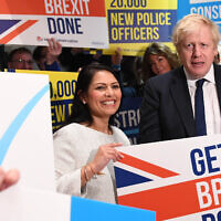 Prime Minister Boris Johnson and Home Secretary Priti Patel on the campaign trail last year (Credit: Press Association)