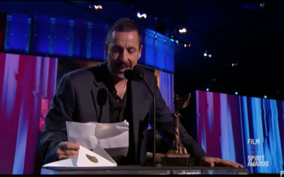 Screenshot from Youtube of awards ceremony, where Adam Sandler picked up the 'best male lead' gong