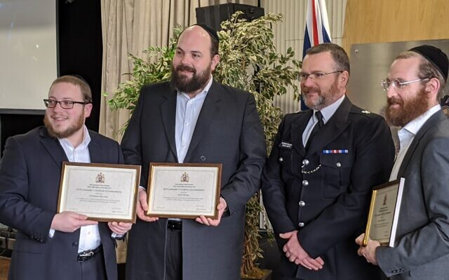 Chief Superintendent Louis Smith, with Gary Ost, Shimon Ostreicher and Shmuel Danciger