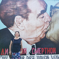Alex at the famous mural known as My God, Help Me to Survive This Deadly Love by Dmitri Vrubel, at the East Side Gallery, featuring Soviet leader Leonid Brezhnev and East German President Erich Honecker