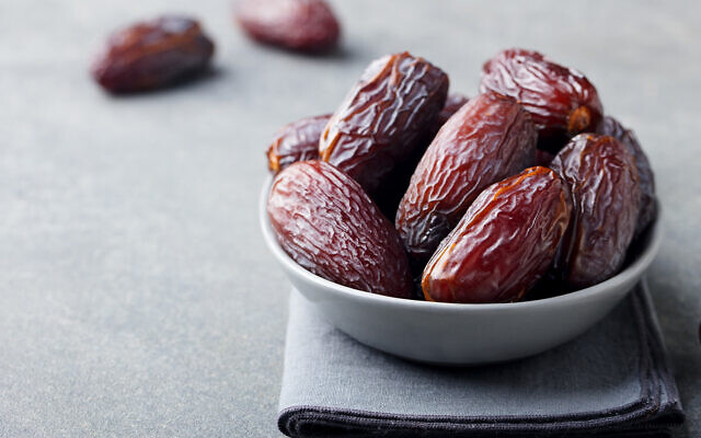 Fresh medjool dates in bowl. (Credit: Getty)