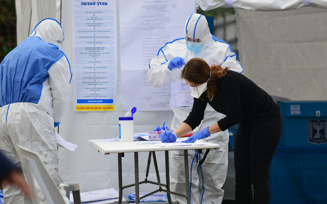 Israelis vote at polling booths specially erected for the 5,600 Israelis under self-quarantine, many of whom visited countries where the coronavirus COVID-19 is prevalent, during the parliamentary election on March 2, 2020. Photo by: Tomer Neuberg-JINIPIX
