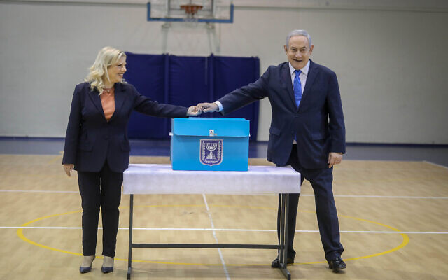 Israeli Prime Minister Benjamin Netanyahu (R) and his wife Sara Netanyahu (L) cast their ballots during the Israeli legislative elections, at a polling station in Jerusalem, 02 March 2020. Israelis are heading to the polls for a third general election, following the prior elections in September 2019, to elect the 120 members of the 23nd Knesset, or parliament. According to the Israel Central Bureau of Statistics, more than six million people are eligible to vote. Photo by: Marc Israel Sellem-JINIPIX