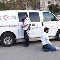Avraham Mintz and Zoher Abu Jama praying together