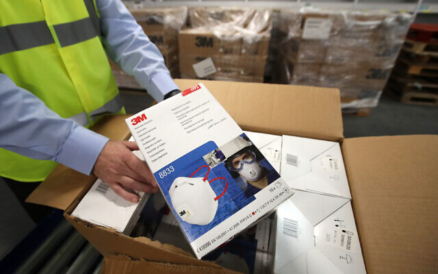 Jim Miller, procurement director from NHS National Services Scotland, holds a box of face masks in Canderside, Larkhall. (Photo credit should read: Andrew Milligan/PA Wire)