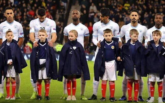 Picture posted online by the Israeli FA, depicting Israeli players in a previous fixture against Scotland, with Scottish ball-boys wearing the Israeli FA's jackets.