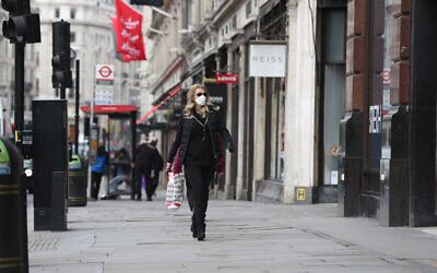A woman wearing a face mask in Regents Street in London