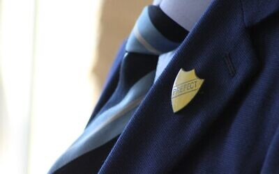 Stock image of a pupil in a school uniform (Credit: Robin Worrall, Unsplash)