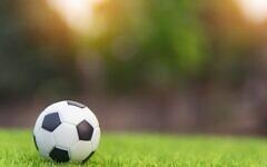 Football (Photo by Tevarak Phanduang on Unsplash)