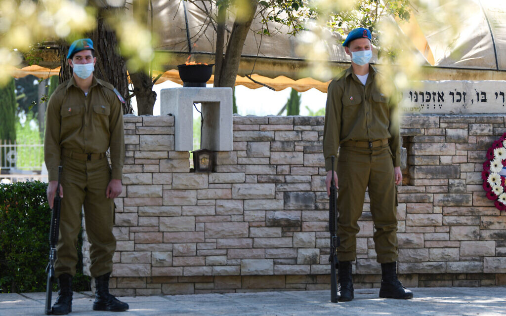 Israeli soldiers at Mount Qiryat Shemona Cemetery as Israel marks Memorial Day for the fallen soldiers and victims of terror on April 28, 2020. This year, due to the outbreak of the Coronavirus, there will be restrictions on going to the cemeteries on Memorial Day itself. Photo by: Ayal Margolin-JINIPIX
