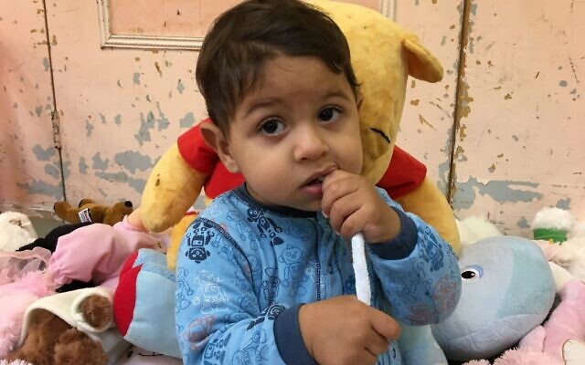 An asylum seeker's child, who has not been named, being supported by United Synagogue