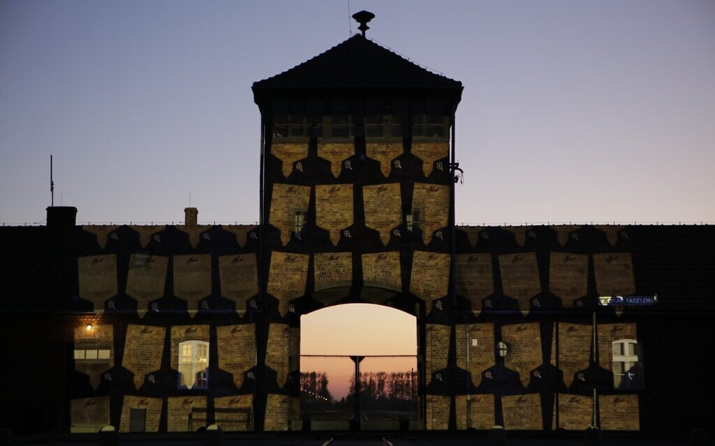 """Thousands of virtual plaques appeared on the infamous gates of Auschwitz-Birkenau   (Credit - """"March of the Living - Marcin Kozlowski"""")"""